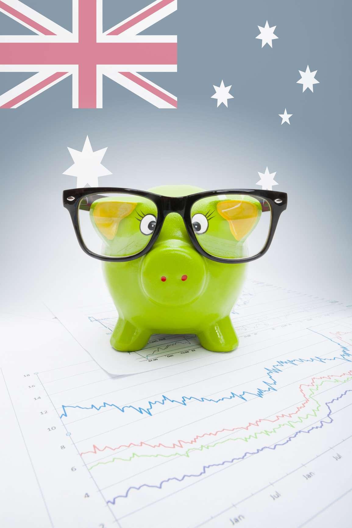 Piggy bank with flag on background - Australia