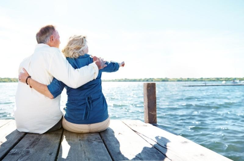 old couple looking out into the ocean
