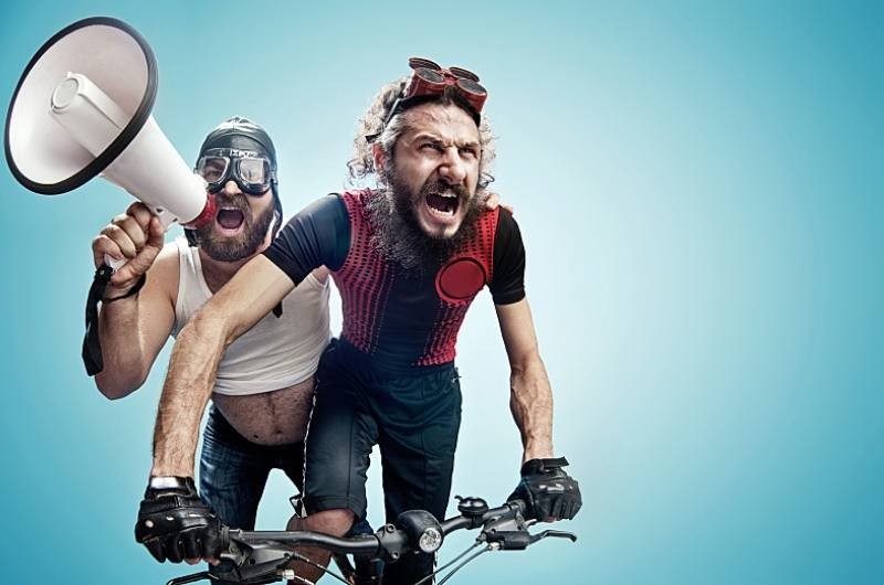 sweaty men on bicycle with loudspeaker