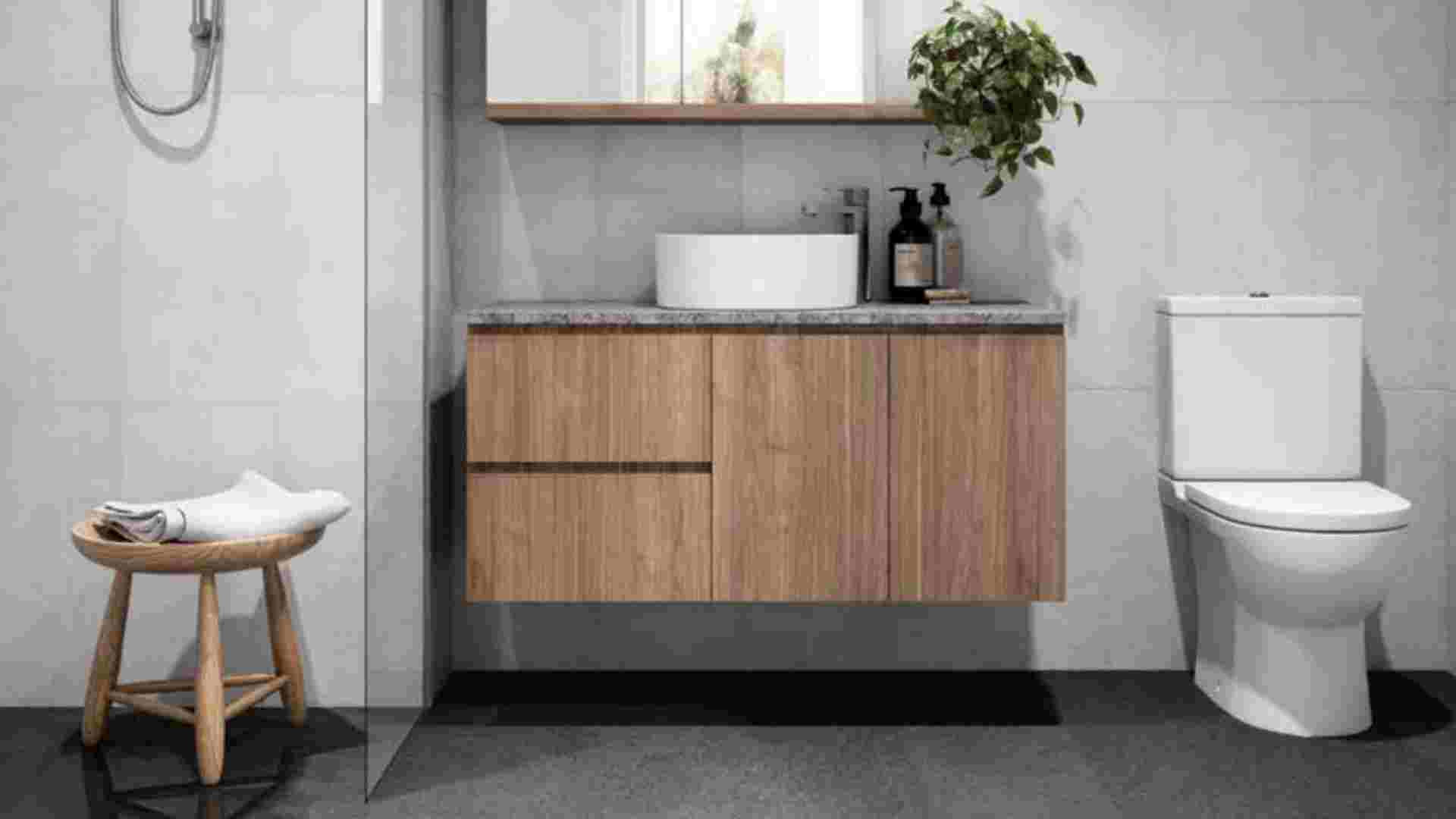 light wooden finish bathroom with marble countertop