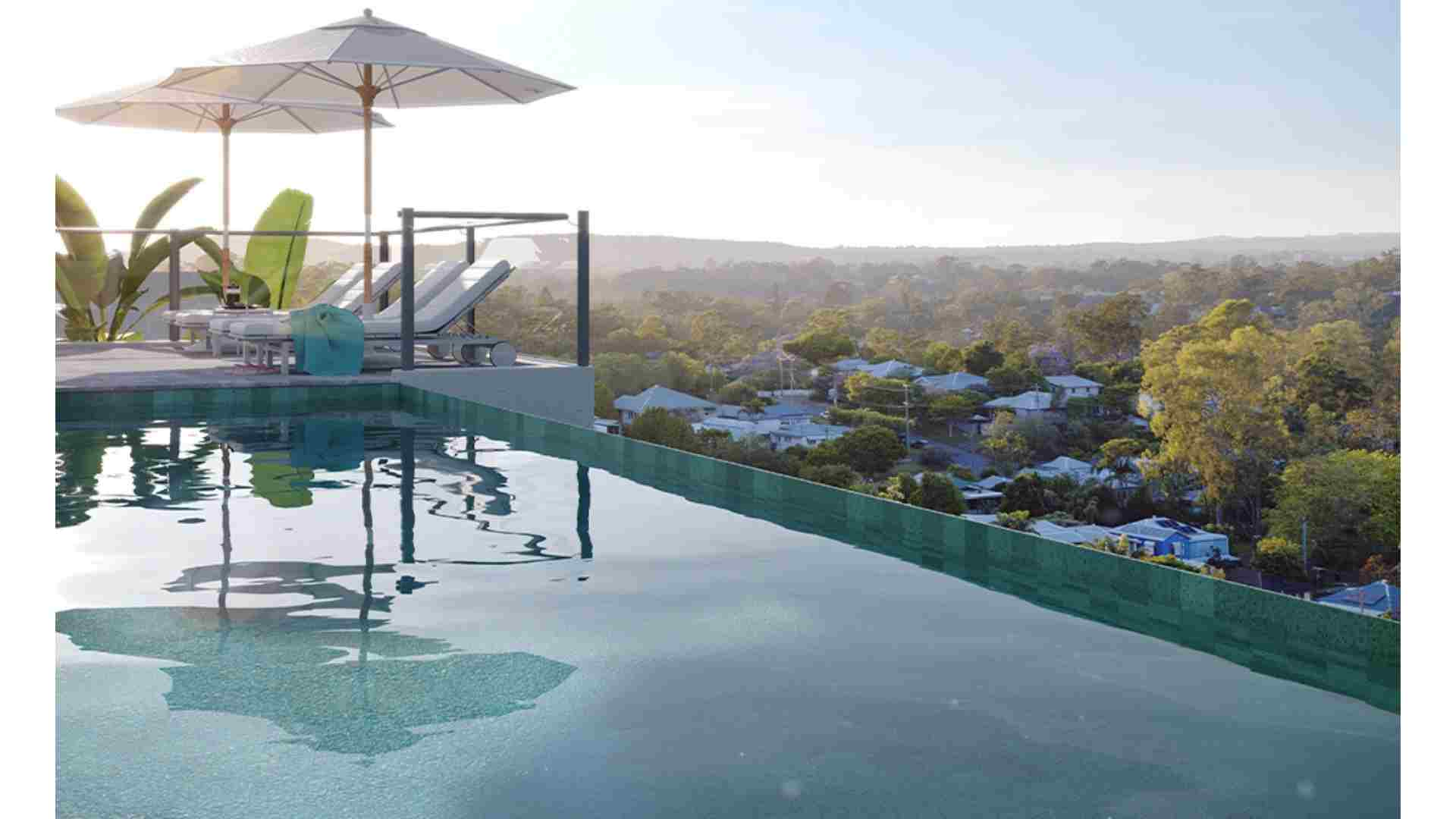 rooftop infinity pool, sunbed and white umbrella