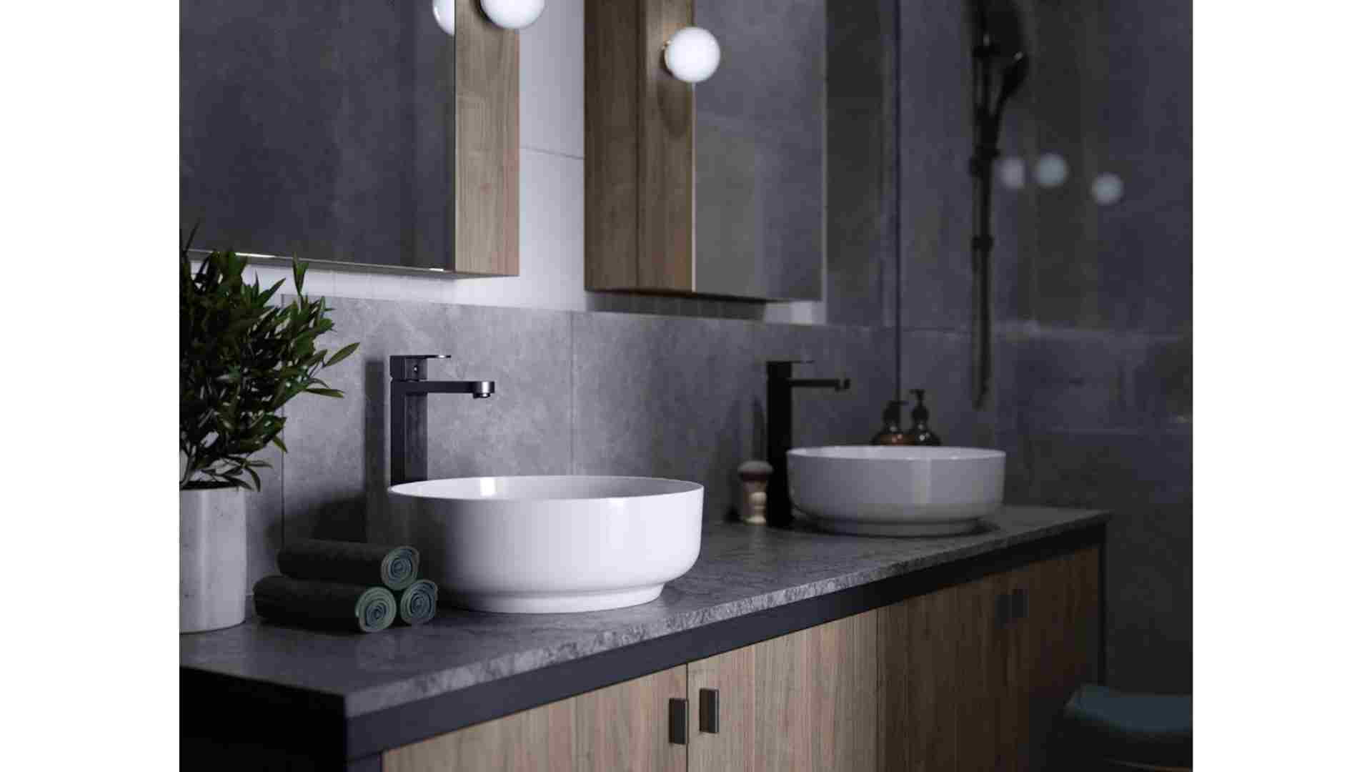 His and hers round white bowl sink, grey marble countertop, rectangle mirror
