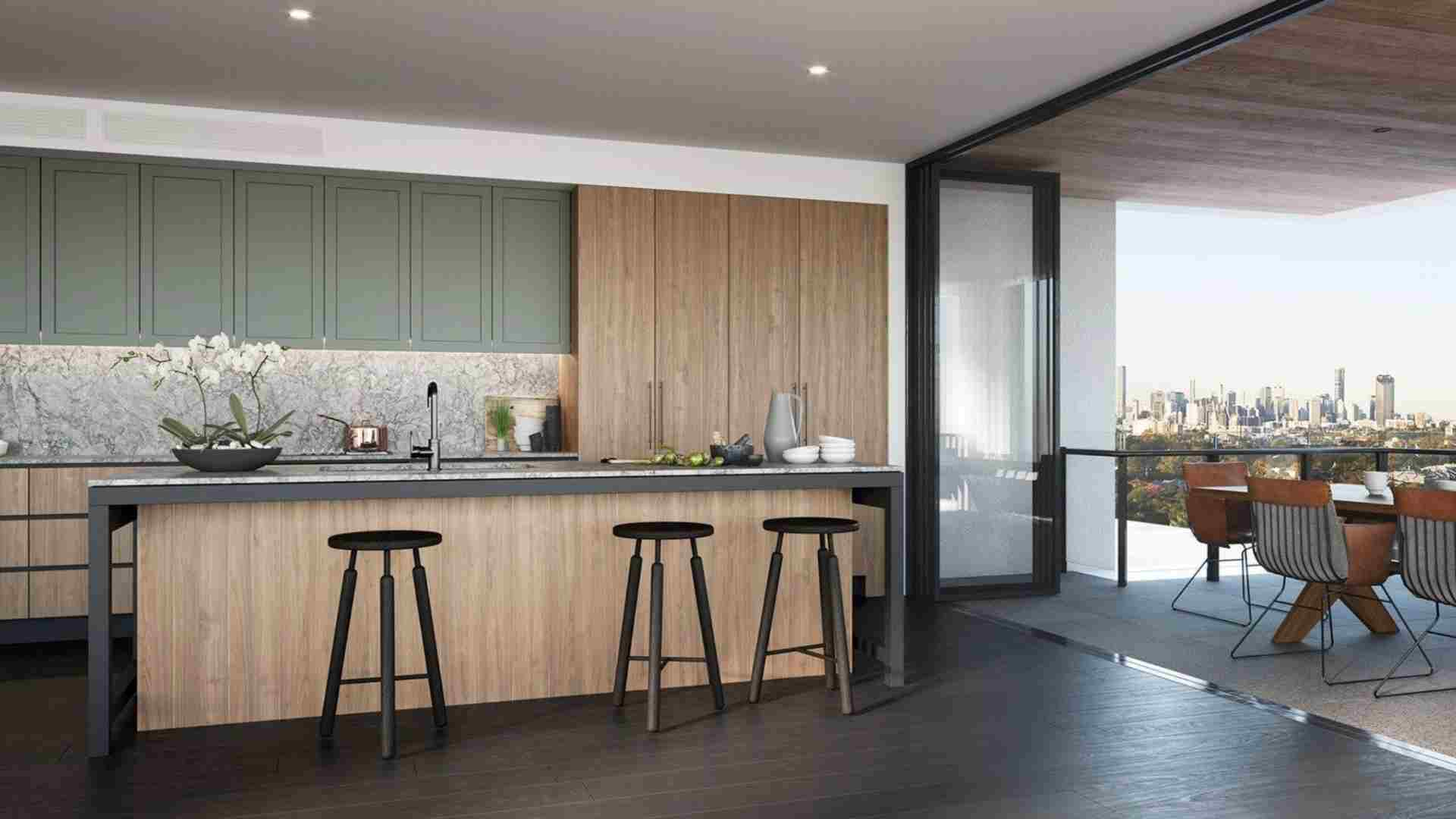 wood and sage kitchen cabinets, black bar stool, open kitchen to balcony