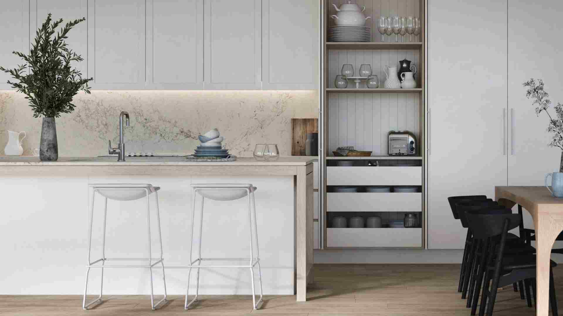 white kitchen cabinets, white marble countertop, wooden flooring
