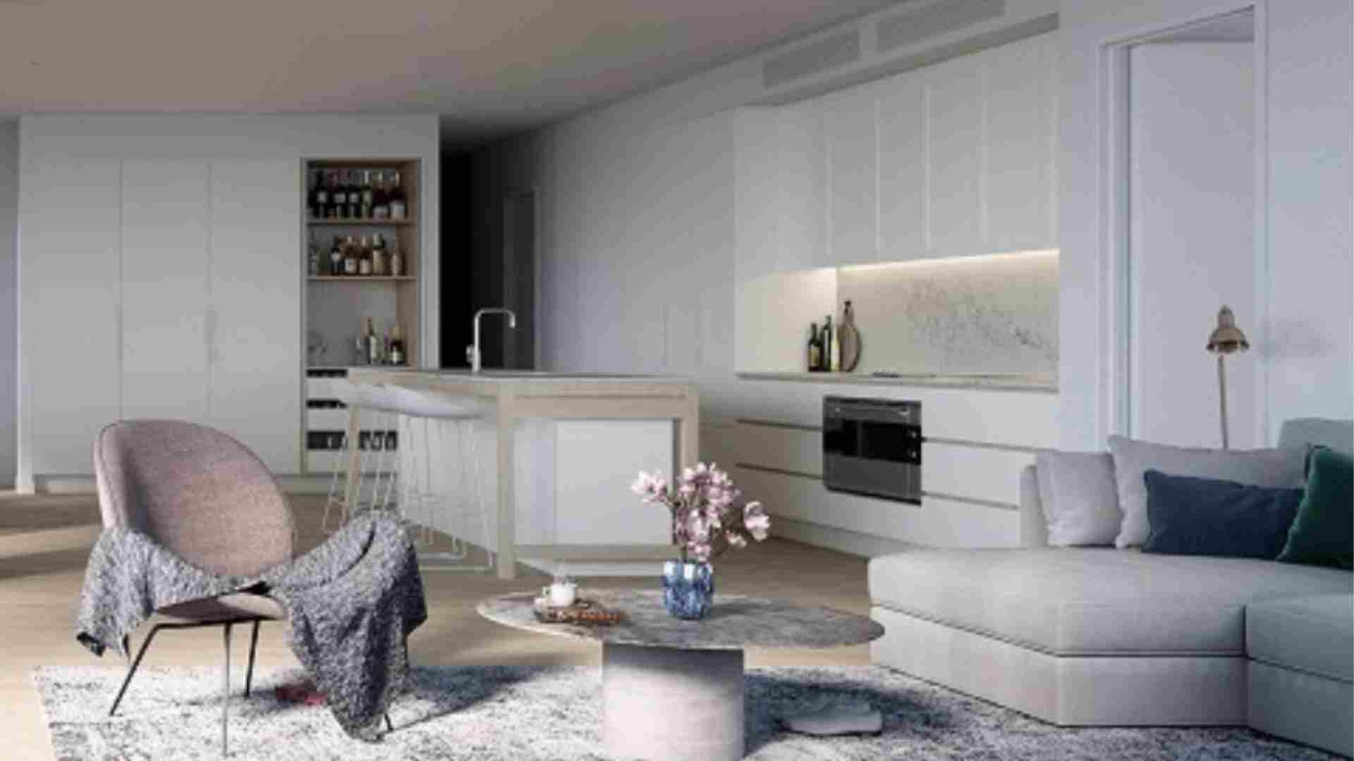 white living interior, marble kitchen countertop, grey sofa, round marble coffee table