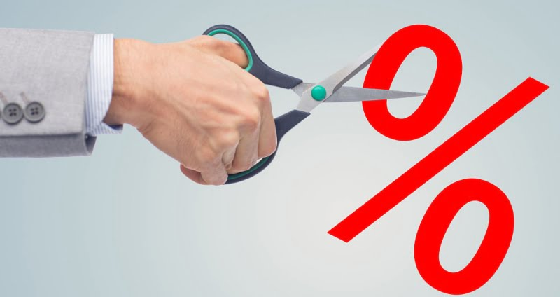 business, people, financial crisis, sale and default concept - close up of businessman hand with scissors cutting percents over gray background