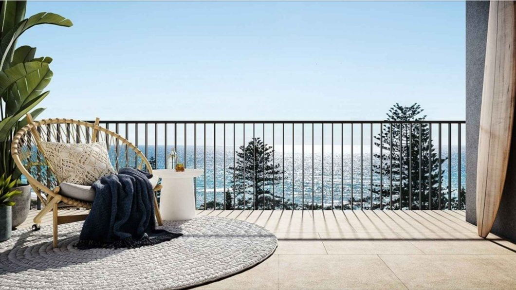 cozy chair on a balcony overlooking the ocean