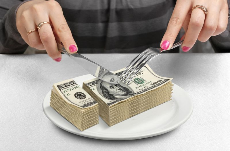 stack of cash on a dinner plate