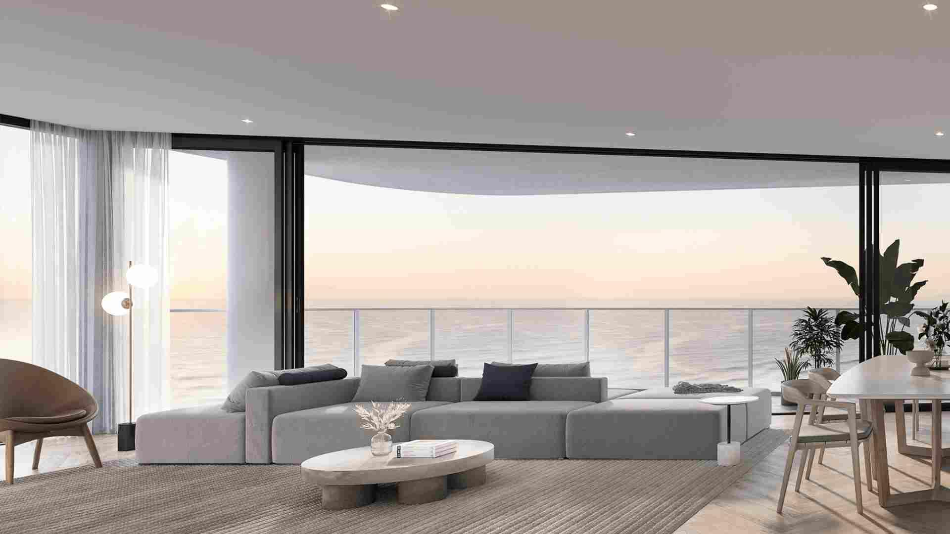 large grey sofa in living room overlooking mermaid beach
