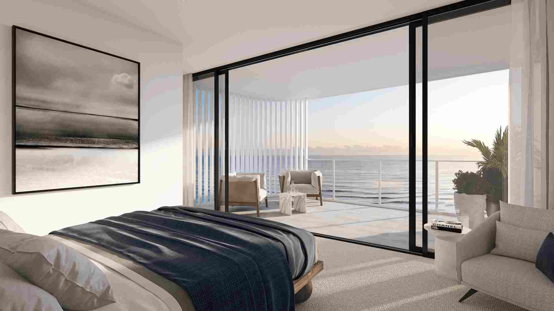 masterbedroom with balcony with a water view