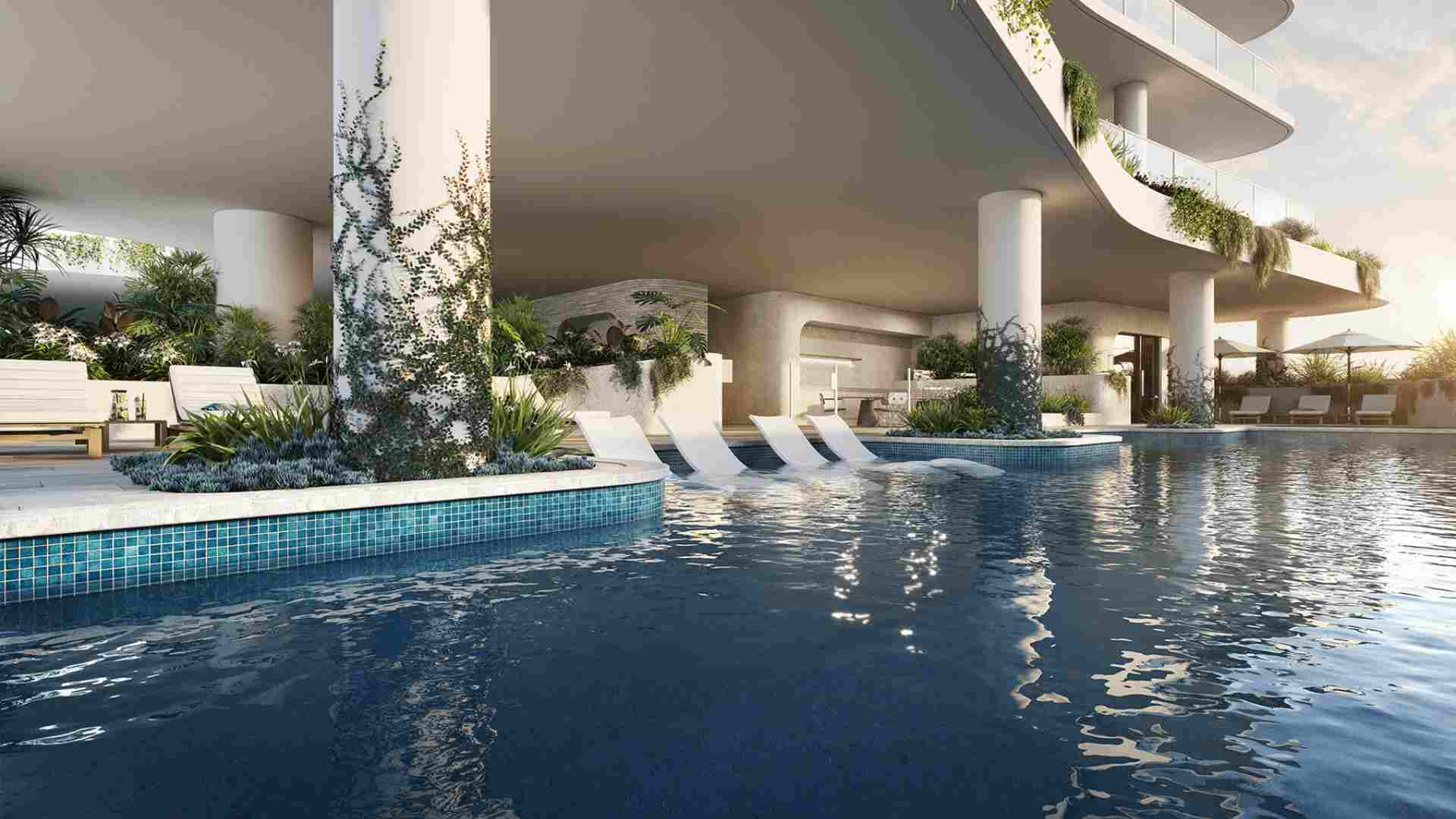 in water lounges by the pool