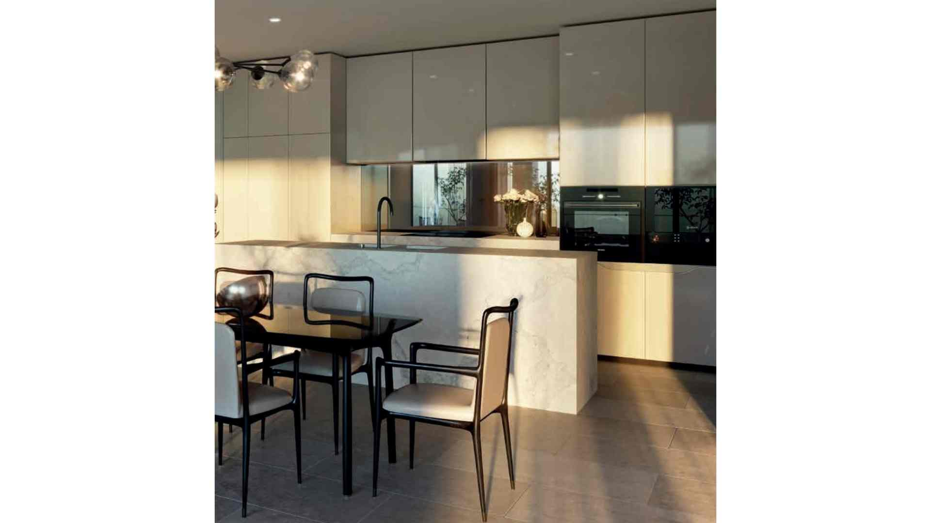 marble kitchen table, cream cabinets, black dining table