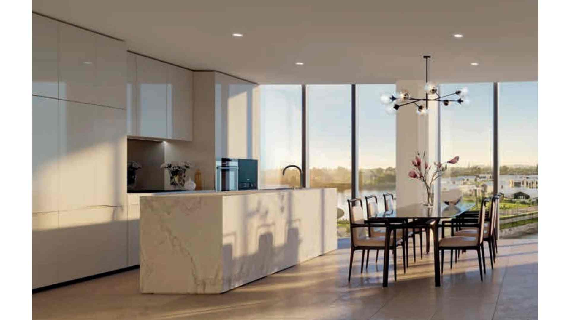 island kitchen next to large dining area space with natural light
