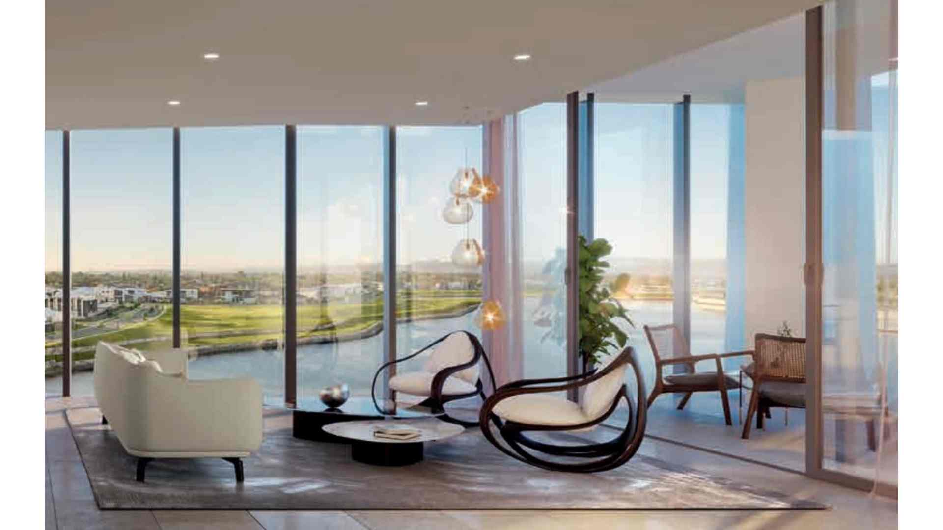 living area connected to balcony with view of the lake