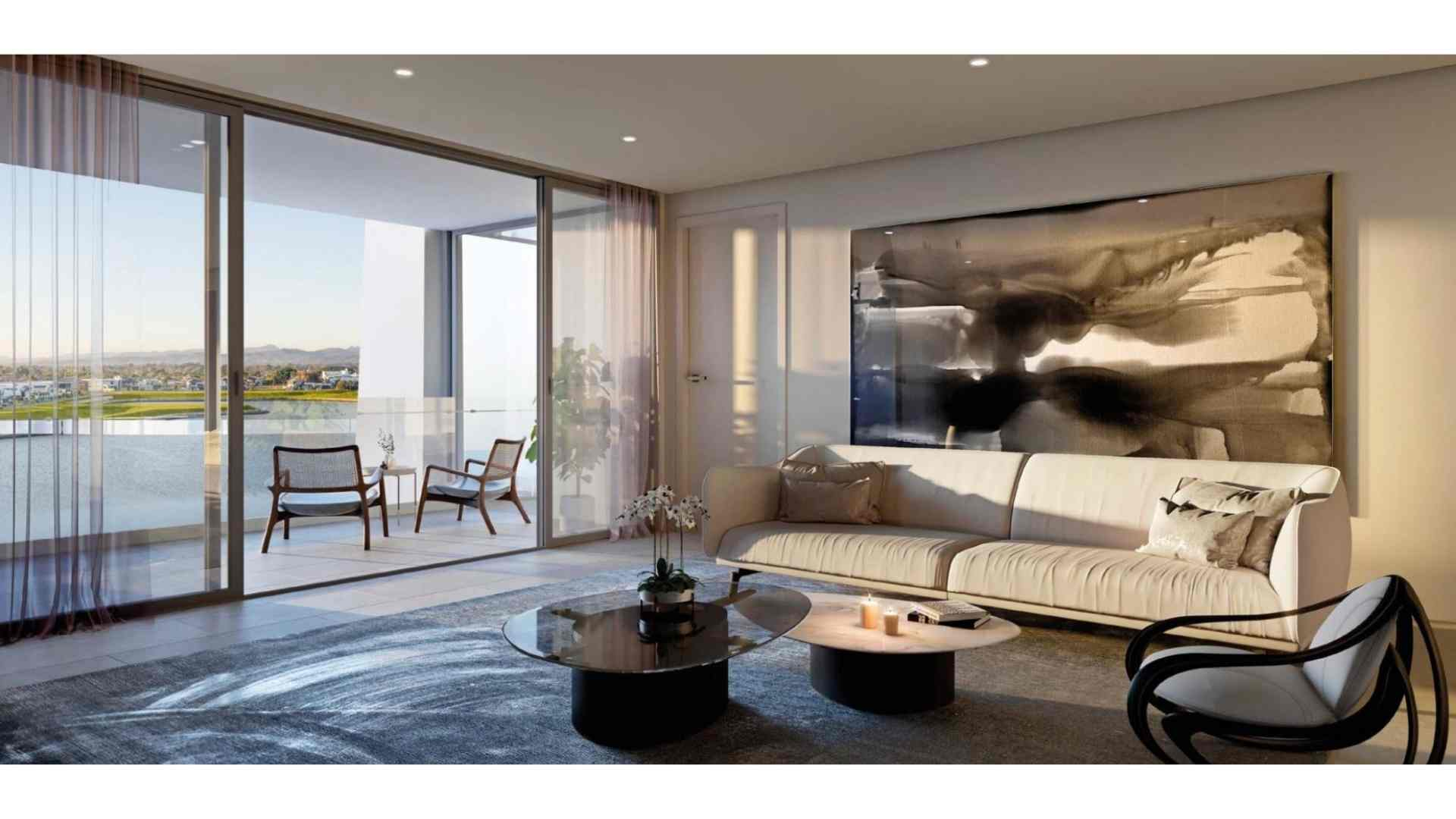 floor to ceiling glass sliding door connecting living room to balcony