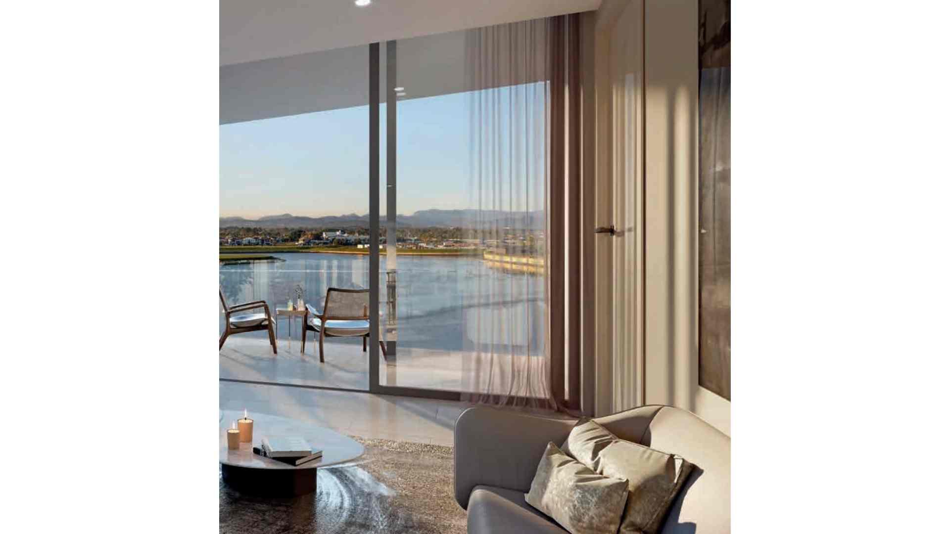 grey sofa on rug by the balcony