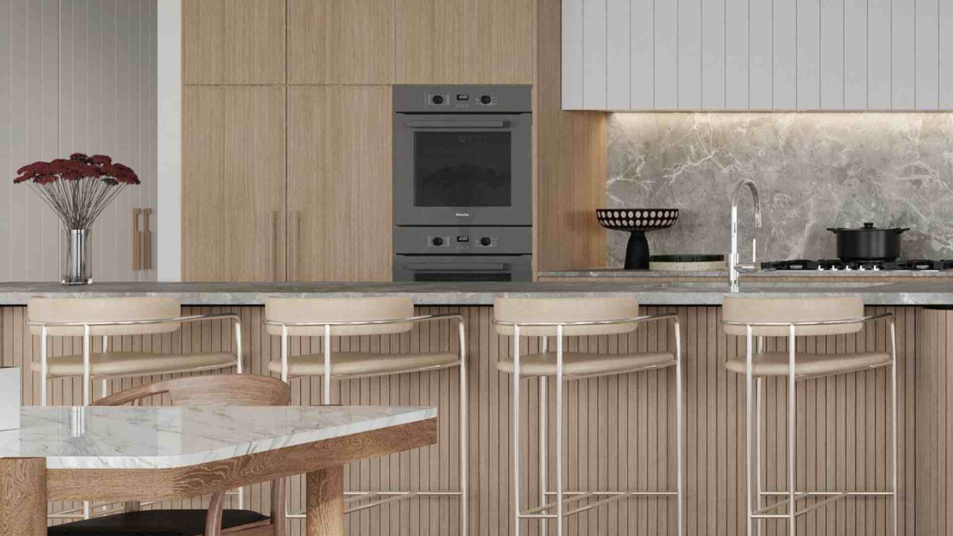 black cast iron pot on stove, grey counter top with wooden kitchen cabinets