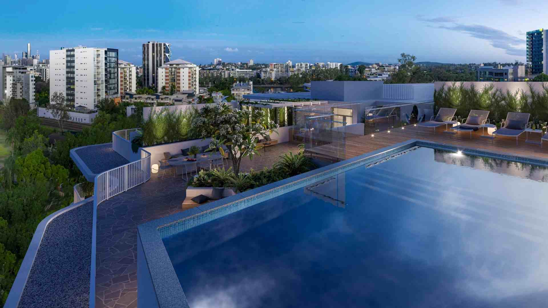 rooftop pool with bbq pit and lounge chairs