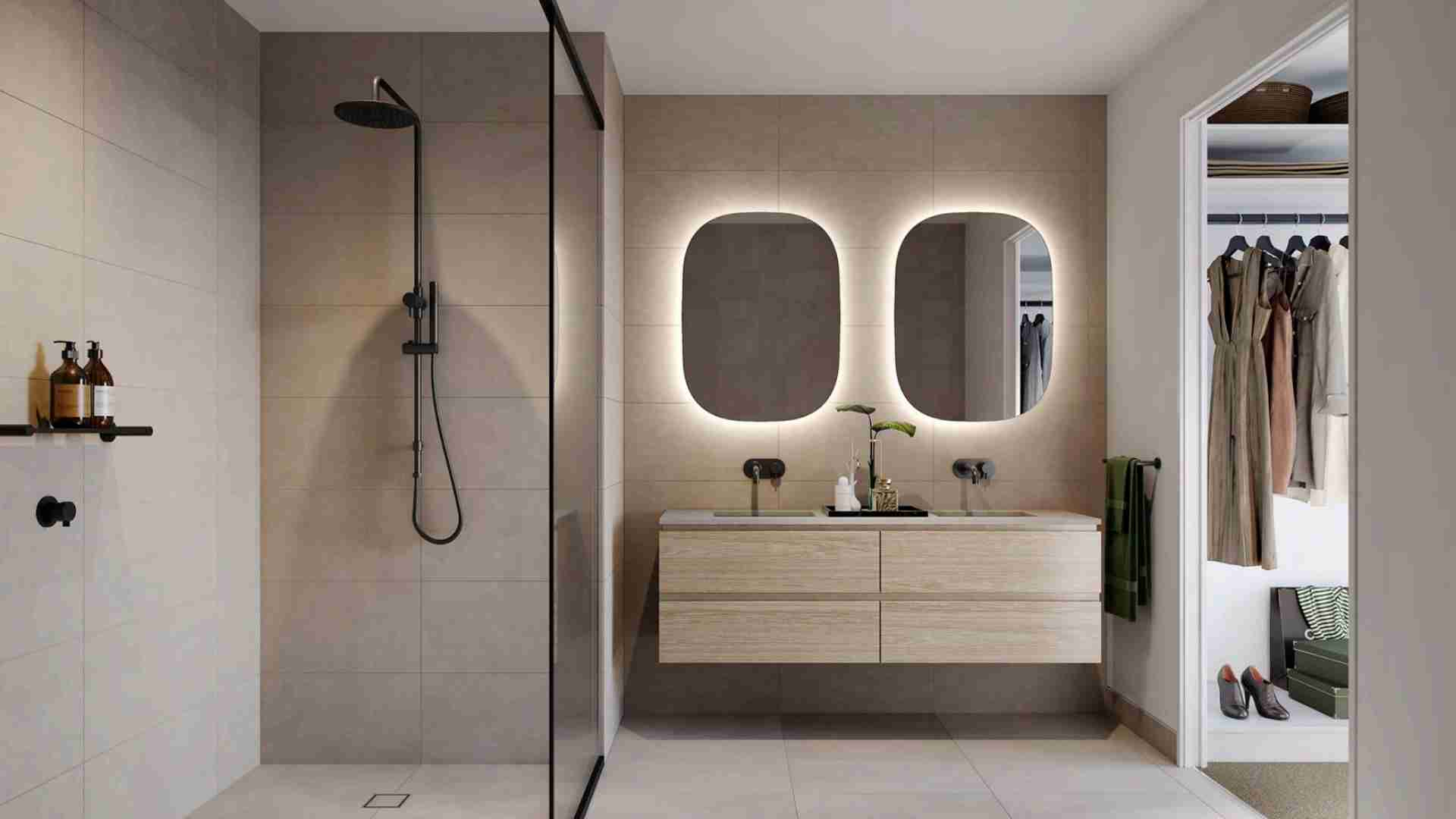 bathroom with black showerhead and beige tiles