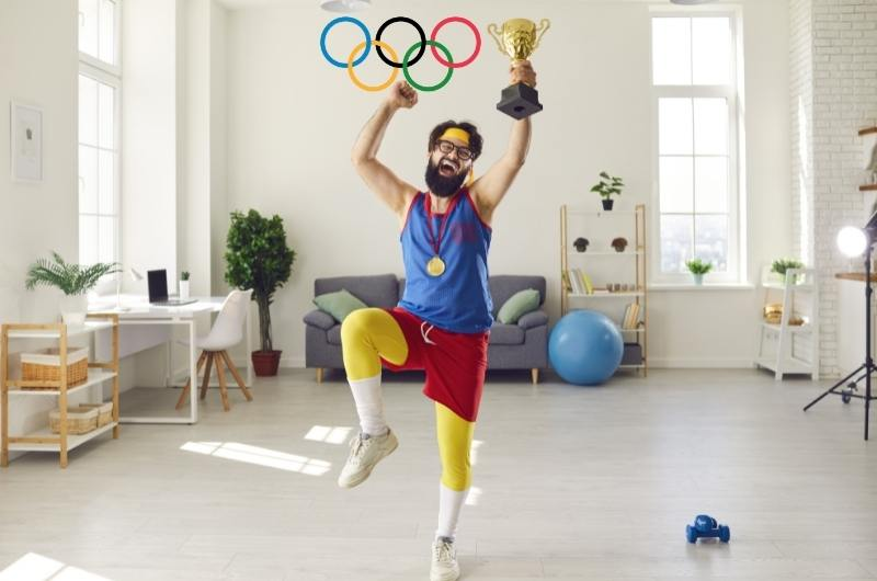 Funny athlete holding his trophy jumping for joy celebrating his victory